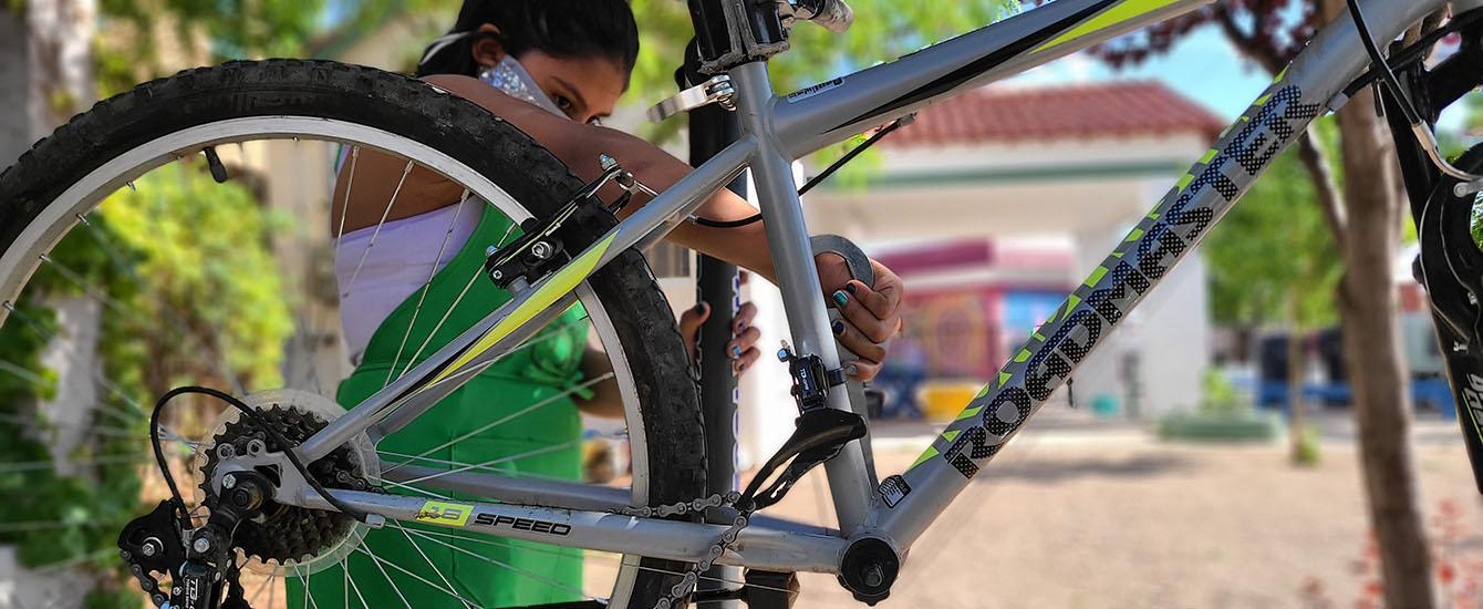 A Young Rider Repairs a Bike at the Center of Southwest Culture