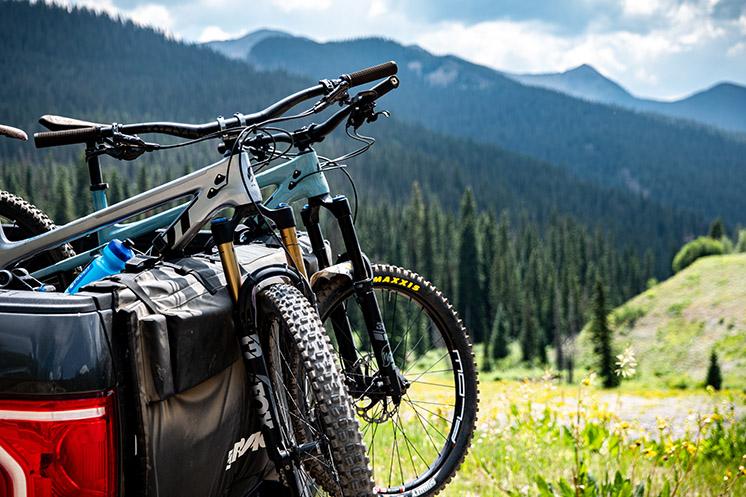 Bikes on truck tailgate pad overlooking scenic vista