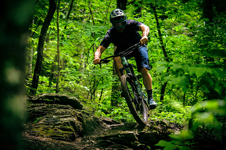 Brice Shirbach rolling over rock feature