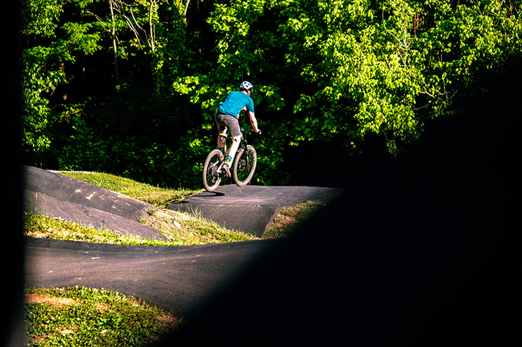 Julian riding roller on paved pump track