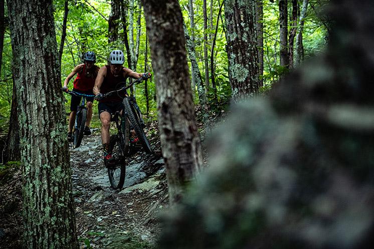 Rider manualing across rock gap