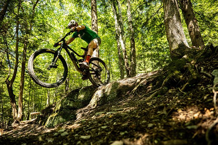 Rider manualing off rock slab